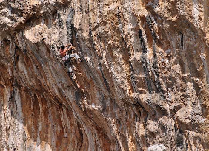 A climber on 'Arugliopoulos' (7c+)