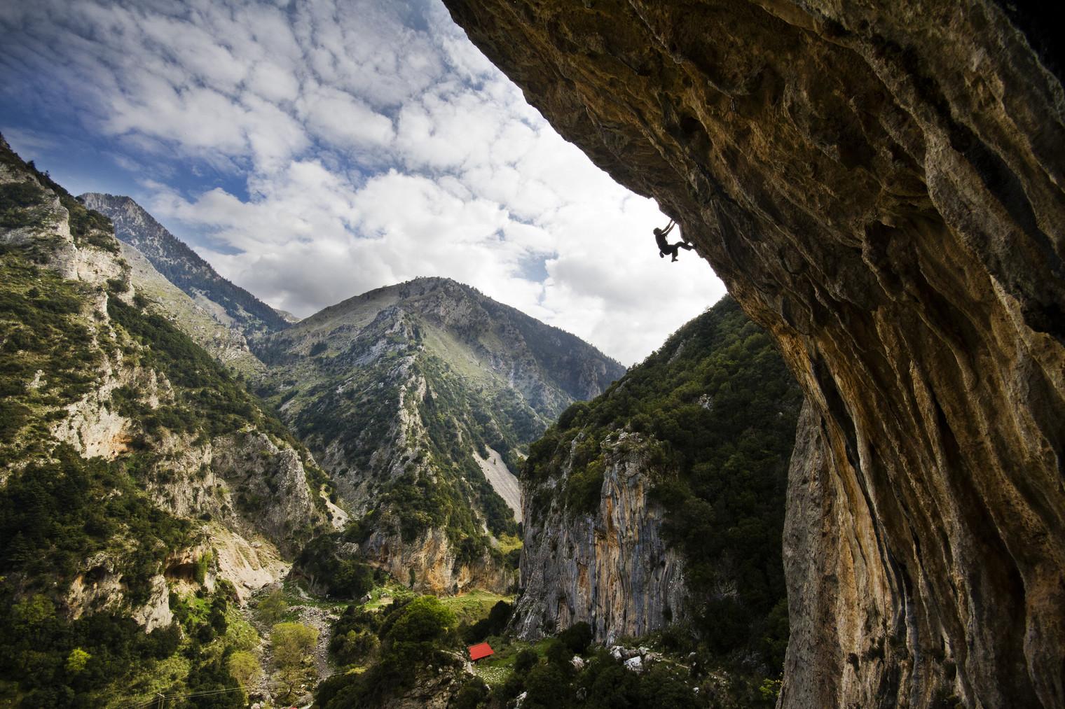 Climber on overhanging cave, Lagada, Sparta, Greece